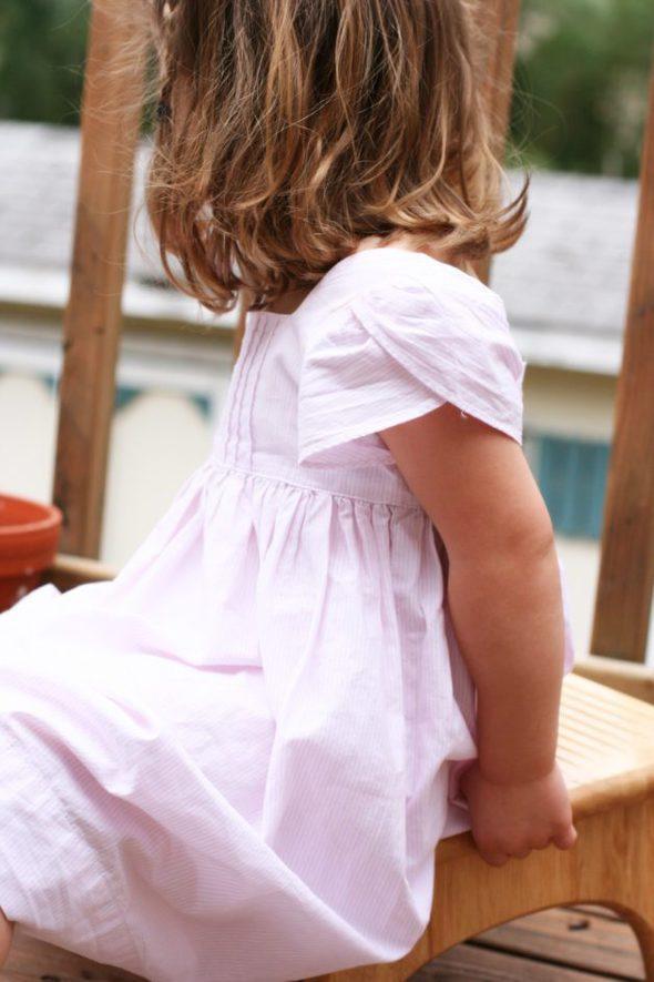 Preschool girl in pink Ralph Lauren dress.