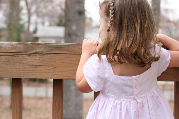 Zoe wearing a pink Ralph Lauren dress.