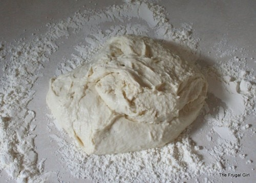 Bread dough on a floured counter.