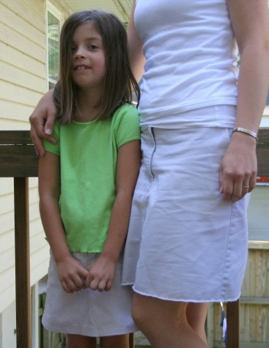 A girl and her mom wearing matching refashioned khaki skirts.