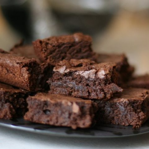 homemade brownies on a plate.