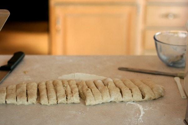 Yeast dough cut into strips.