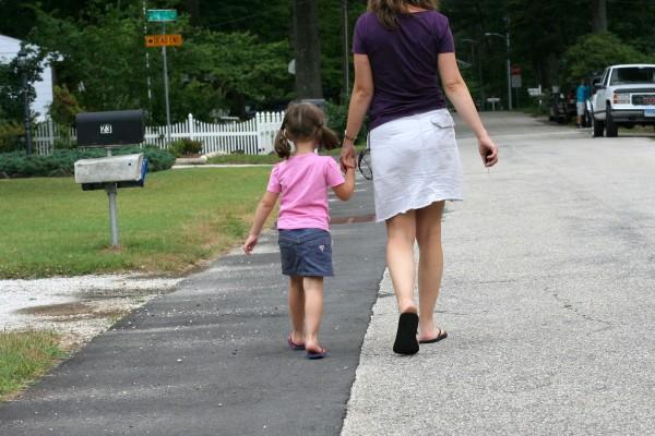Kristen and Zoe walking hand in hand.