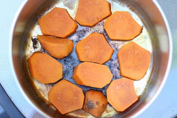 Burnt sweet potatoes in a pan.