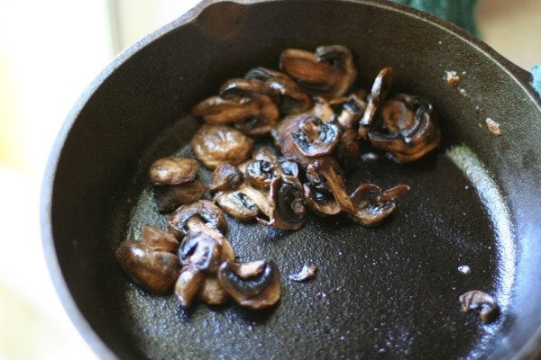 Sauteed mushrooms in a skillet.