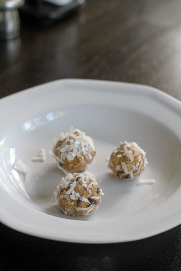 Three peanut butter energy balls, rolled in coconut.