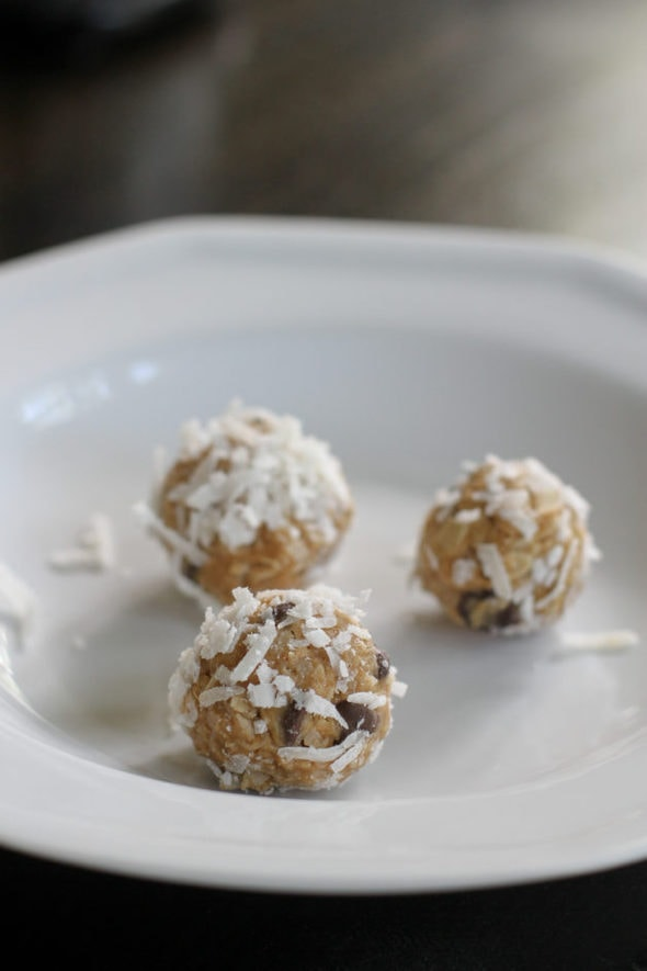 Three peanut butter energy balls on a white plate.