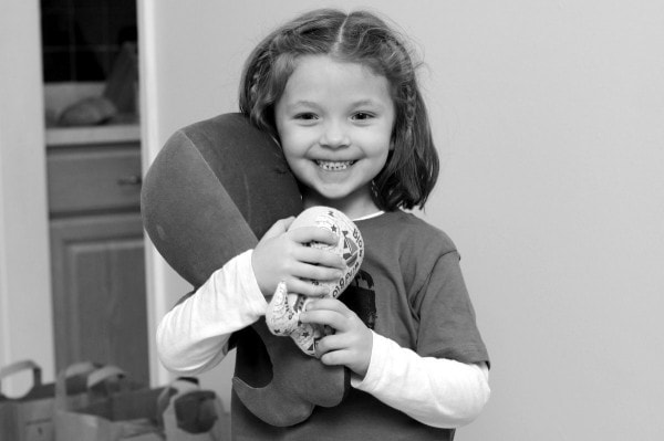 Zoe with her fluffyland whale