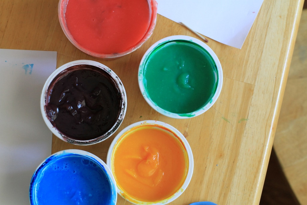 Five containers of finger paint.
