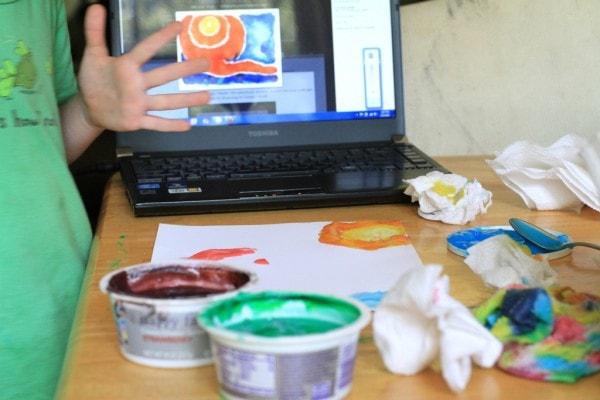 A child using finger paint.