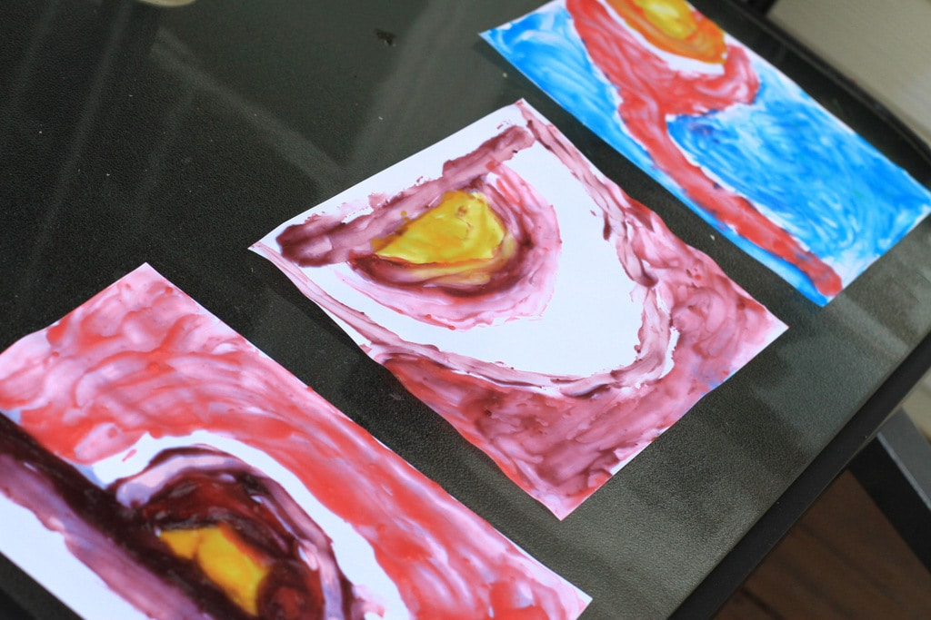 Watercolor paintings drying in the sun.