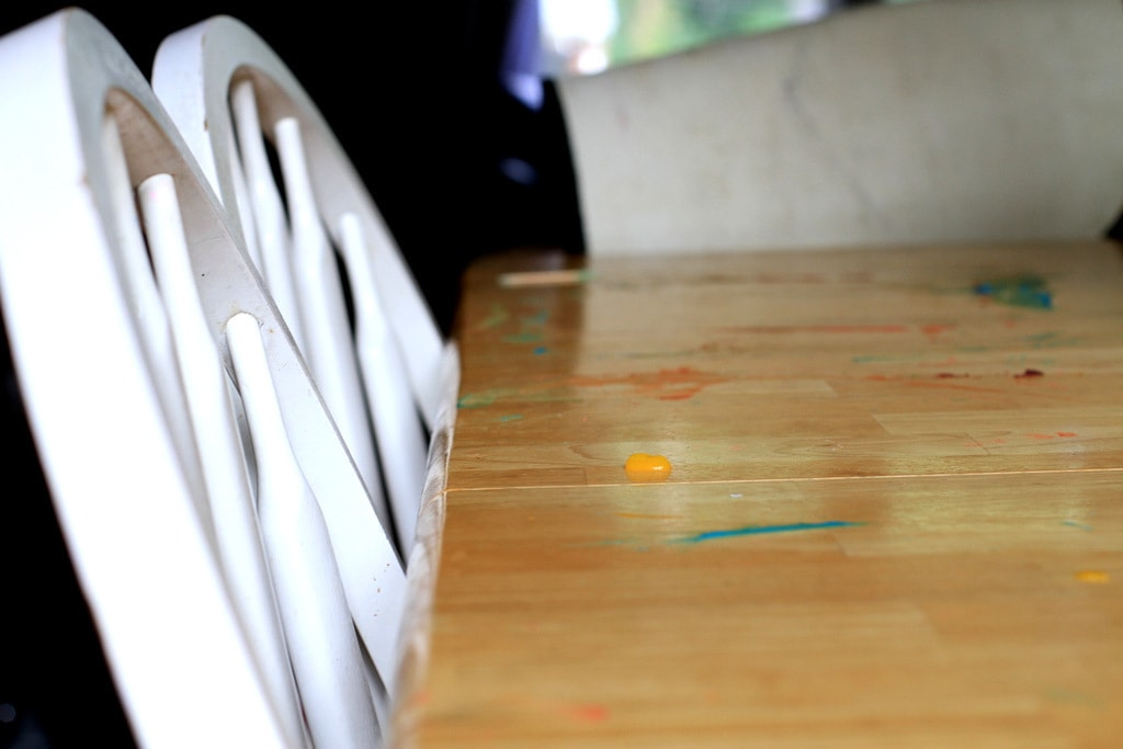 A table with finger paint on it.
