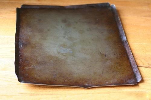 A worn nonstick cookie sheet