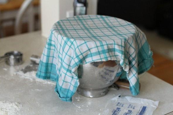 cover bread dough with a tea towel