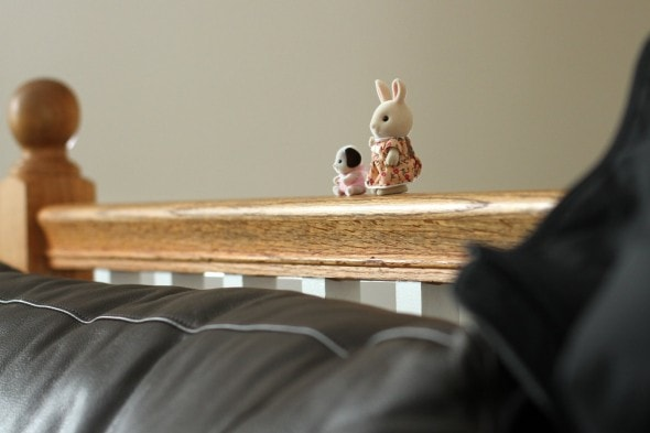 Calico Critters on railing