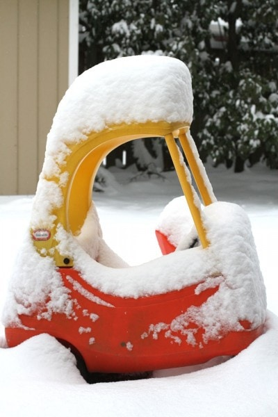 cozy coupe covered in snow