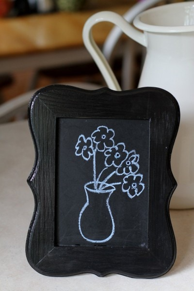 flowers on chalkboard frame