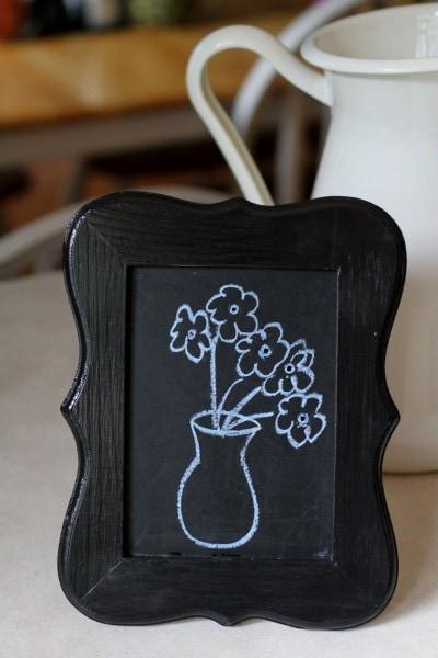 flowers on chalkboard frame