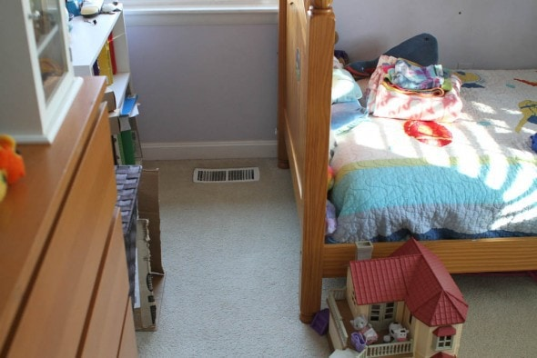 A view of a child's bed and dresser