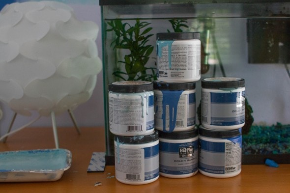 7 cans of sample paint