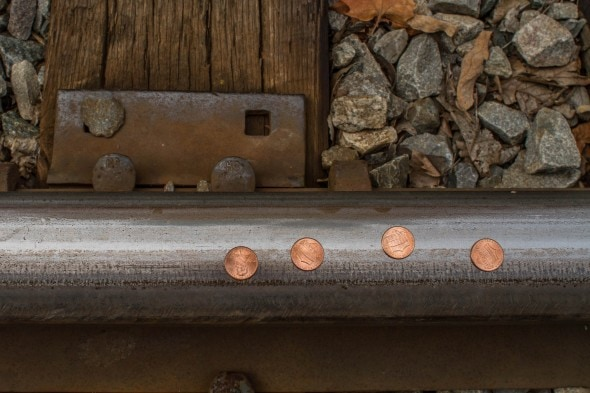 pennies on railroad tracks