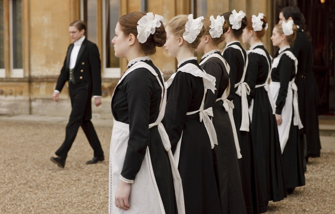 A row of maids from Downton Abbey.