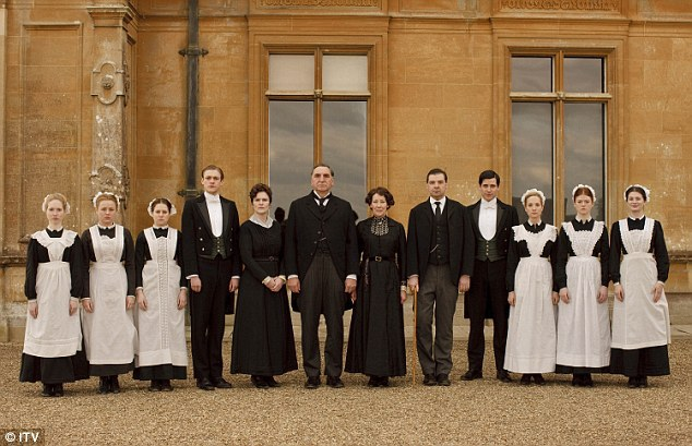 The staff of Downton Abbey, lined up outside.