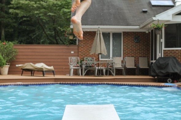 A view of a backyard swimming pool.