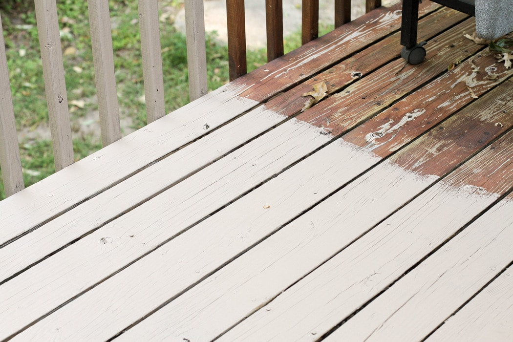 A deck partially stained with Behr taupe paint.