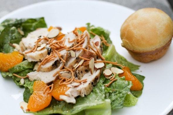 A mandarin chicken salad on a white plate.