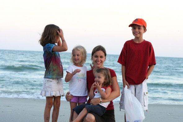 Kristen with her kids on a beach.