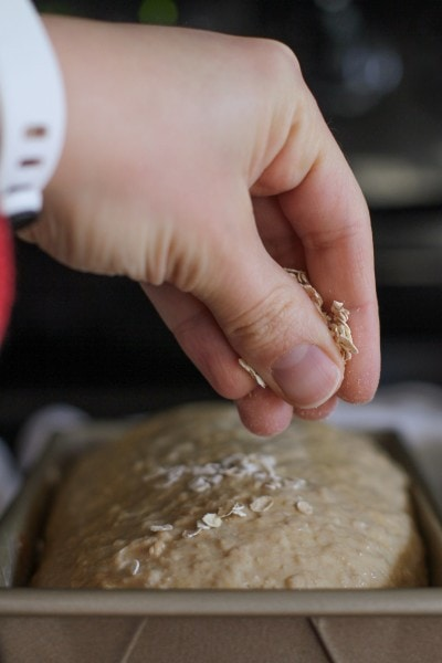 sprinkle oats on top of bread