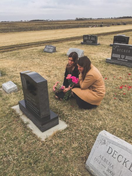 Kristen and her sister in a cemetery