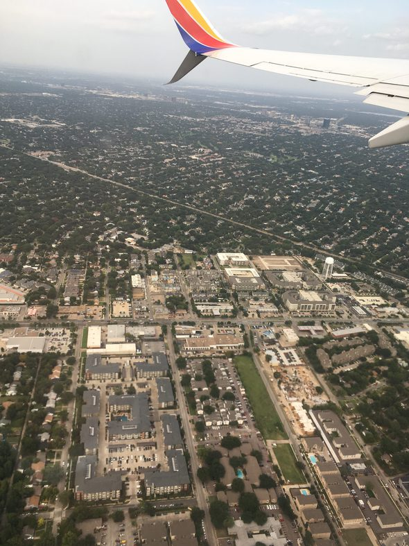 A view of a city from an airplane window.