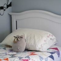 A white twin bed with drawers