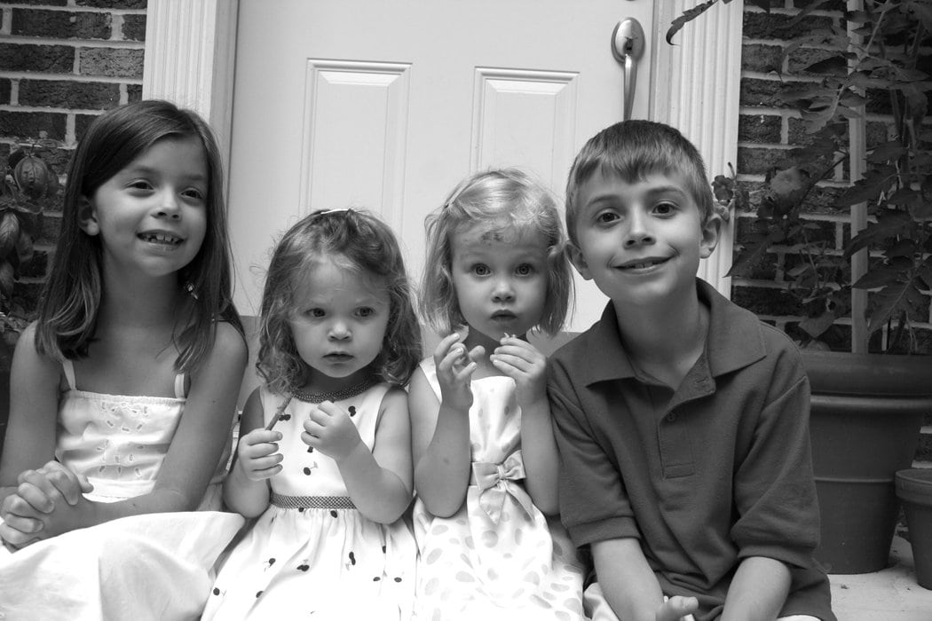 Joshua, Lisey, Sonia, and Zoe sitting on the steps