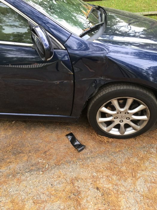 wrecked blue sedan