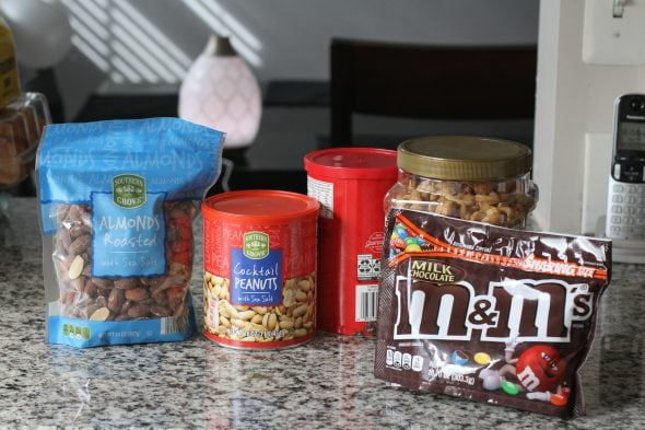 Trail mix ingredients on a countertop.
