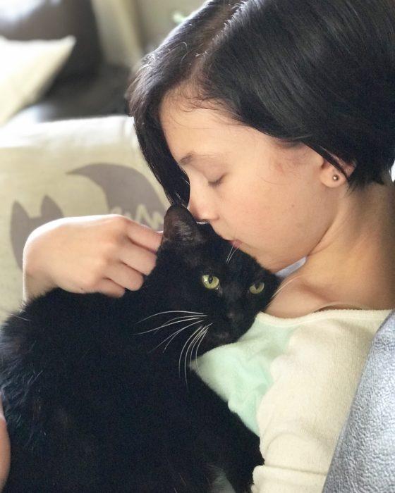Zoe snuggling the cat