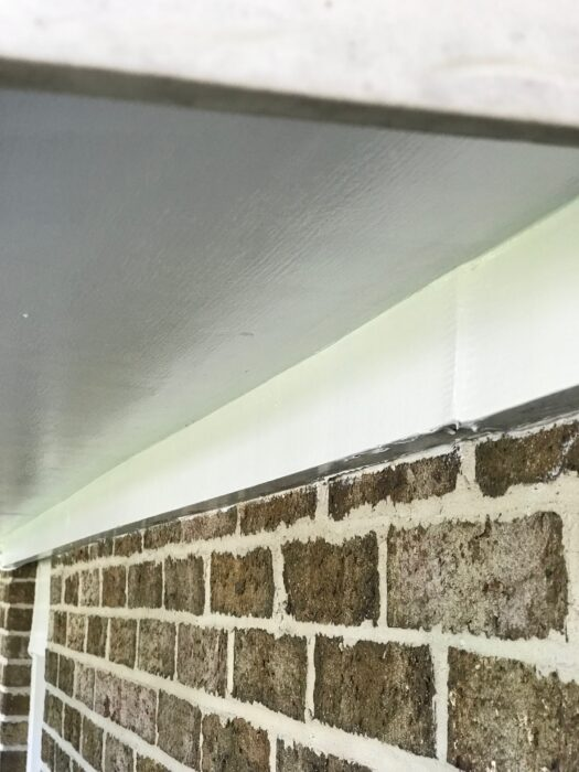 repainted white plywood soffit
