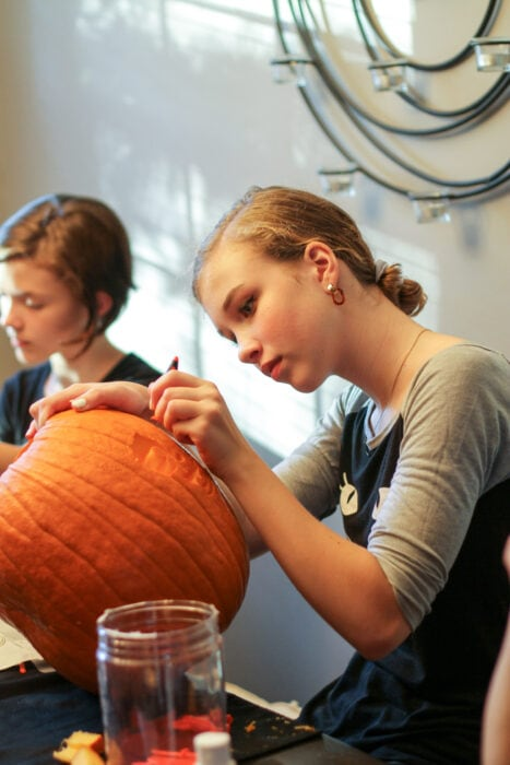Sonia carving Halloween pumpkin