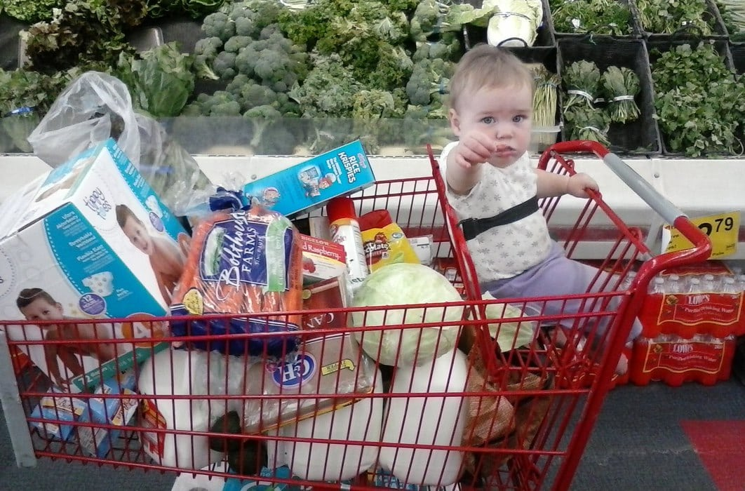 baby in grocery cart