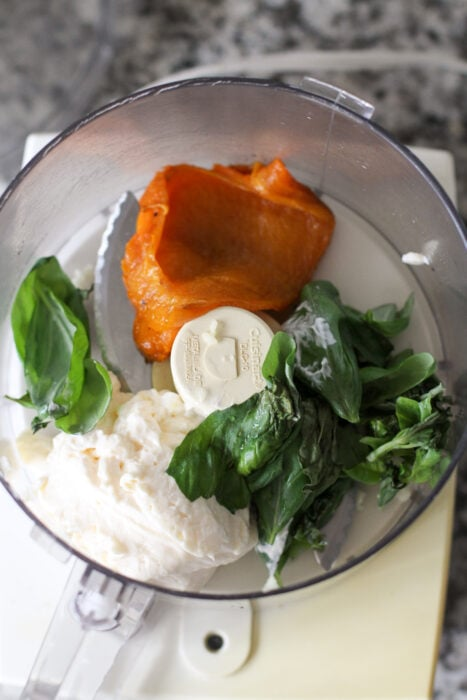 Roasted red pepper mayo ingredients in a food processor.