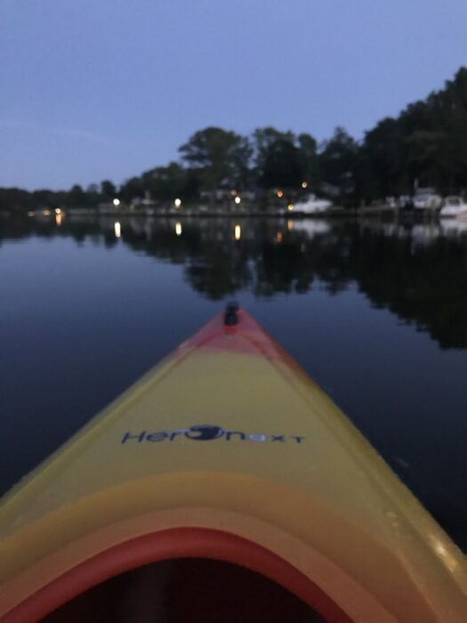 kayak on a river at night