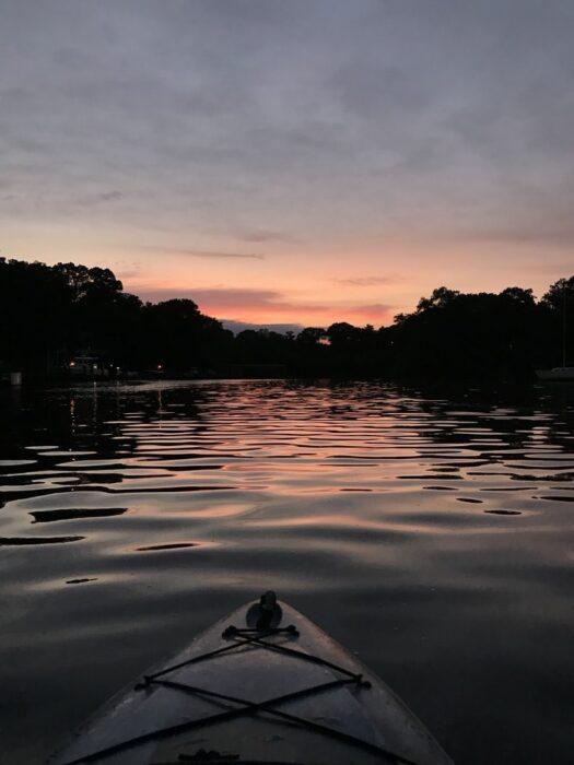kayak on a river at night
