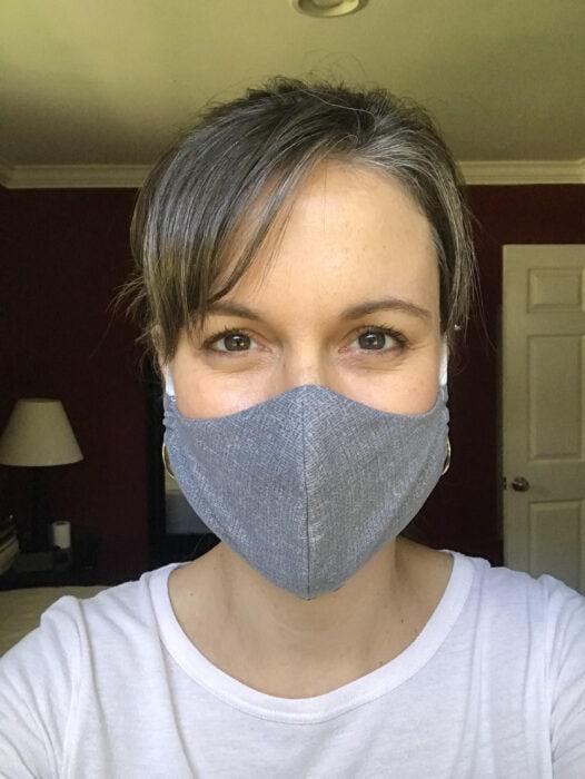 Kristen wearing a homemade gray fabric mask