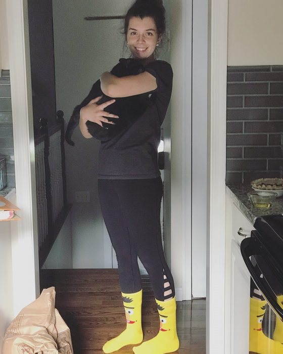 Lisey holding a cat and wearing Bert socks