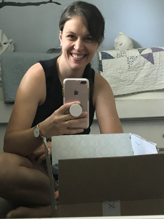 Kristen getting ready to open Stitch Fix box