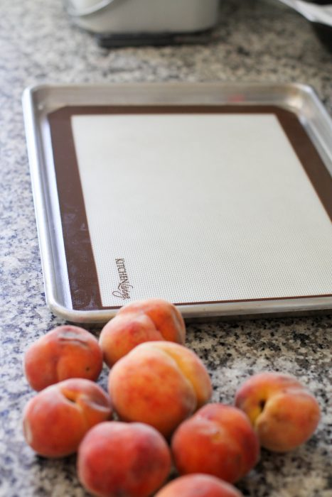 Baking sheet lined with silpat for peach freezing