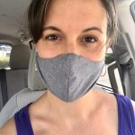 Kristen wearing a gray fabric face mask